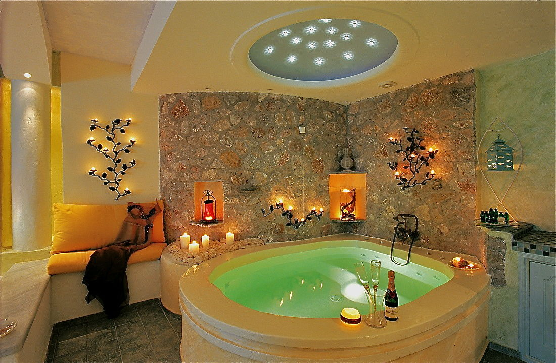 2_Honeymoon_suite_private_couples_Jacuzzi_sea_volcano_caldera_views_Astarte_Suites_Santorini_island