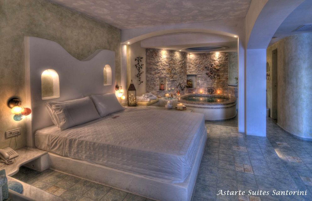 4_Honeymoon_suite_private_couples_Jacuzzi_sea_volcano_caldera_views_Astarte_Suites_Santorini_island
