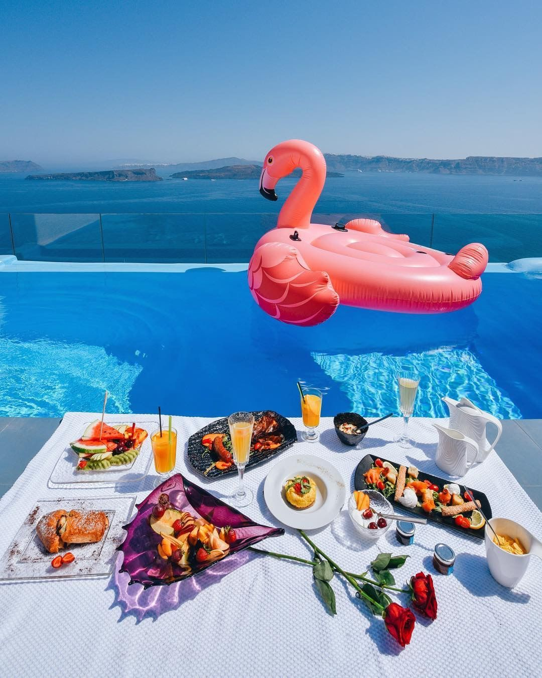 Breakfast_poolside_in_Santorini_island_-_Astarte_Suites_Luxury_Hotel_flamingo
